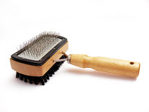 Pets brush. Close up of the hairbrush to brush pets, isolated on white background Royalty Free Stock Images