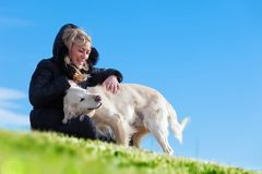 Pets and dogs.training and educating dogs.Companion pets concept. Woman and dogs portrait playing in the park.Companion pets concept Royalty Free Stock Photos