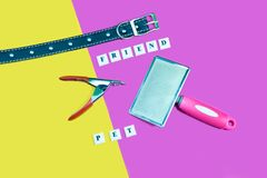 Pets are friends concept. Collars and brush nail scissors. For dog or cat on yellow and pink background Stock Photography