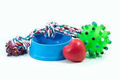 Pets are friends concept.  Pet bowl and rubber toys. With rope for dog or cat isolated on white background Royalty Free Stock Photo