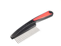 Pets grooming comb. On white background Royalty Free Stock Images