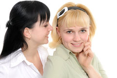 Pettegolezzo d'ascolto delle giovani donne Fotografia Stock