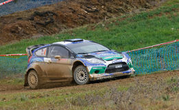 Petter Solberg (NOR) driving is Ford Fiest RS WRC. ALGARVE, PORTUGAL - MARCH 31: Petter Solberg (NOR) driving is Ford Fiest RS WRC in Rally de Portugal 2012 on Stock Photography