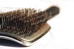 Pettine con il tessuto felpato dei capelli Fotografie Stock