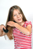 Pettine della spazzola di capelli della ragazza Fotografie Stock