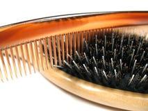 pettine vicino della spazzola in su Fotografie Stock