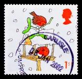 Pettiross sulla Tabella dell'uccello, Natale 2001 - serie dei pettiross, circa 2001 Fotografia Stock Libera da Diritti