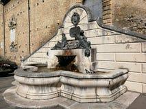 Pettorano sul Gizio - Sculptural fountain of Neptune and Amphitrite. Pettorano sul Gizio, Abruzzo, Italy - March 15, 2019: Monumental fountain of Neptune and royalty free stock images