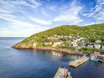 Petty Harbour with two piers during summer sunset, Newfoundland, Stock Image