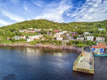 Petty Harbour with two piers during summer sunset, Newfoundland, Royalty Free Stock Photography