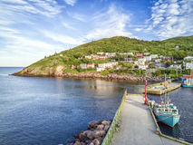 Petty Harbour with two piers during summer sunset, Newfoundland, Canada. Beutiful Petty Harbour with two piers during summer sunset, Newfoundland and Labrador stock photo