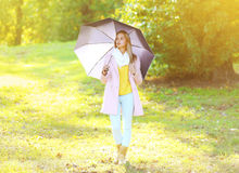 Petty sensual woman with umbrella in sunny autumn Royalty Free Stock Photos