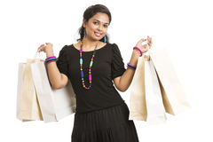 Petty Young woman posing with shopping bags Stock Image