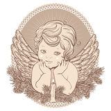Peu d'ange avec des ailes avec une bougie Images stock