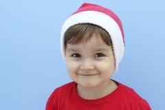 Peu d'enfant habillé comme sourire du père noël Photo stock