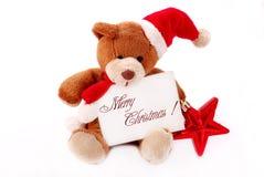 Peu d'ours de nounours avec avec des souhaits de Noël Photo stock