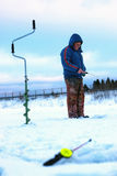 Peu de canne à pêche d'hiver image libre de droits