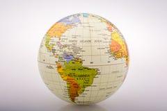 Peu de globe modèle coloré avec la carte Photos libres de droits