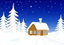 Peu de maison en paysage de l'hiver Photos stock