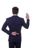 Peu fiable, se trouvant, doigts d'homme d'affaires croisés Photographie stock libre de droits