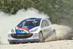 Peugeot 207  rally car. Paolo Andreucci  with  Anna Andreussi (co-pilote)    drives his Peugeot 207  S2000 during the 2012 San Crispino Rally  in Gubbio (Italy) Royalty Free Stock Photo