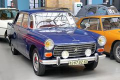 Peugeot 404. BERLIN, GERMANY - AUGUST 12, 2014: French retro car Peugeot 404 in the museum of vintage cars Classic Remise stock image