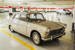 Peugeot 404. CANNES, FRANCE - AUGUST 3, 2014: Beige retro car Peugeot 404 at the underground parking stock images