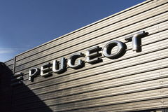 Peugeot car company logo in front of dealership building on March 31, 2017 in Prague, Czech republic. PRAGUE, CZECH REPUBLIC - MARCH 31: Peugeot car company logo Stock Photography
