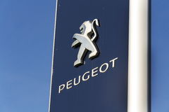 Peugeot car company logo in front of dealership building on March 31, 2017 in Prague, Czech republic Royalty Free Stock Images