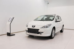 Peugeot car for sale. Peugeot car in showroom for sale stock photos