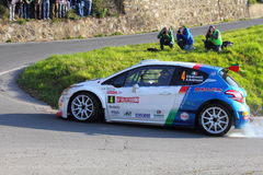 Peugeot 208 Competitive engaged during the 64th rally of Sanremo. Conducted in the race crew Andreucci-Andreussi Stock Photo