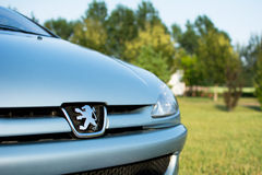Peugeot 206 coupe cabriolet parked in the park. Peugeot 206 cc, manufactured in 2004. Photographed font of a car on a nice sunny day. Interior is black-blue royalty free stock image