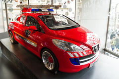 Peugeot H2O. Fire engine concept car in the showroom on the Champs Elysees in Paris, France, on February 20, 2014 Royalty Free Stock Photo