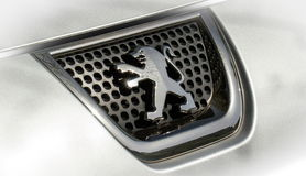 Peugeot icon. Peugeot icon on the front grille of the car Royalty Free Stock Image
