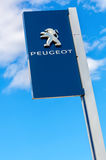 Peugeot logo on a sign outside the car or automotive dealership Royalty Free Stock Photos