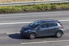 Peugeot 208 na drodze Zdjęcia Royalty Free
