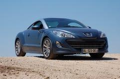 Peugeot RCZ. Blue peugeot sport car with alloy wheels stock photography