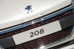 Peugeot 208 registration plate. Laverstoke, Hampshire, UK - August 25, 2016: Closeup of a showroom auto grille and registration plate on a Peugeot 208 model Royalty Free Stock Photo