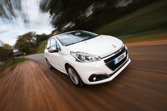 Peugeot 208 on the road stock photos