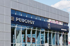Peugeot sign on building of service center. Ulyanovsk, Russia - July 22, 2017: Peugeot sign on building of service center stock images