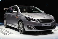 2014 Peugeot 308 SW on the Geneva Auto Salon. Peugeot's engineers and designers have conceived and designed a grand dynamic estate car, with a low, classy and Royalty Free Stock Photos