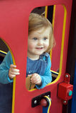 Peuter bij speelplaats stock fotografie