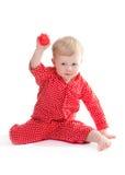 Peuter in rode pyjama Stock Foto's