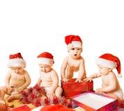 Peuters in de hoeden van Kerstmis stock fotografie