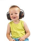 Peuterzitting met hoofdtelefoons Royalty-vrije Stock Foto