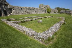Pevensey Castle in East Sussex. Inside the ruin of the historic Pevensey Castle in East Sussex, UK. It is a medieval castle and former Roman Saxon Shore fort royalty free stock image
