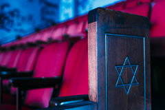 Pew - Abandoned Hebrew Jewish Synagogue - New York. An interior view of a pew with red seats and a star in an abandoned Hebrew Jewish synagogue in New York royalty free stock photos