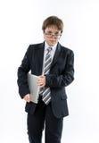 Pewny nastoletni chłopak z laptopem obraz stock
