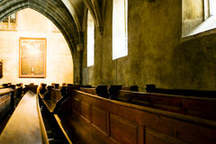 Pews in a cathedral Stock Images