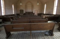 Pews in a Methodist Church in ghost town Bodie. stock image